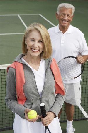 only mature women: Happy Couple on the Tennis Court