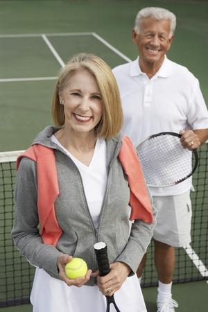 Happy Couple on the Tennis Court Stock Photo - 5470118