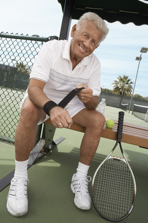 early 60s: Tennis Player Wrapping His Wrist Supporter