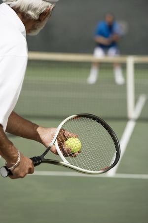 tennis racquet: Man Preparing to Serve