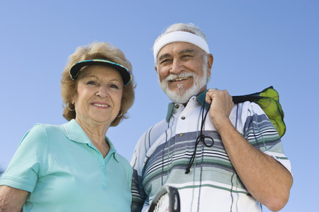Senior couple holding tennis equipment, portrait Stock Photo - 5470122