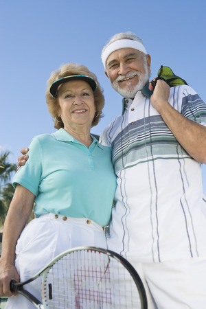 Senior couple holding tennis equipment, portrait Stock Photo - 5470123