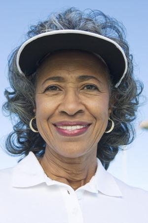 visor: Woman wearing sun visor, portrait LANG_EVOIMAGES