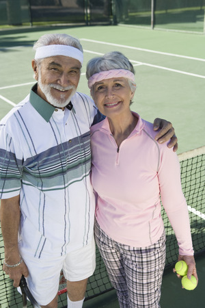 Senior couple at tennis court, portrait Stock Photo - 5470130
