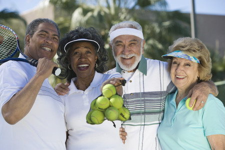 Two couples playing tennis, portrait Stock Photo - 5470153