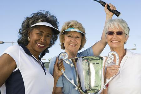 賞カップのテニス選手 写真素材