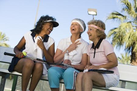 70s tennis: Three women on tennis court