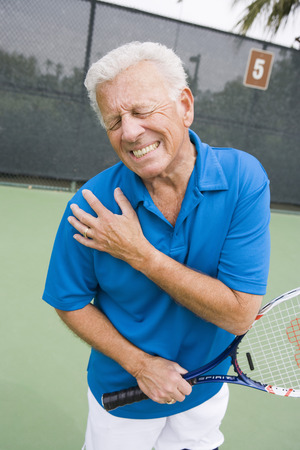 Tennis player suffering from shoulder injury Stock Photo - 5470208