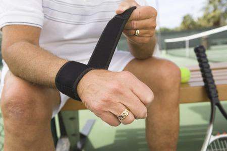 wristband: Tennis player putting on wristband