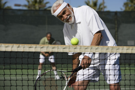 70s tennis: Man playing tennis