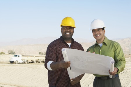 racially diverse: Two Construction Workers on Site