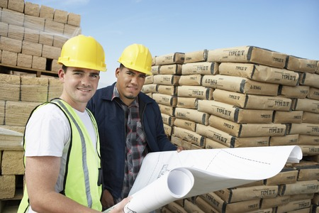 construction crew: Two Construction Workers on Site