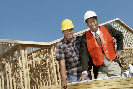 managing: Surveyor and Construction Worker on Site