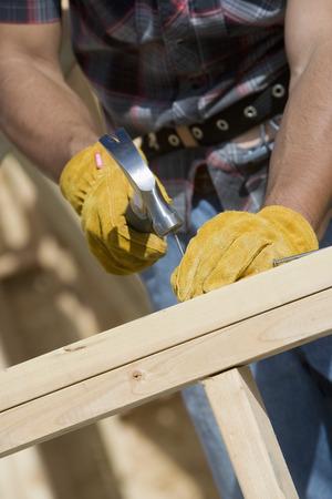 hammering: Construction worker using hammer, close-up