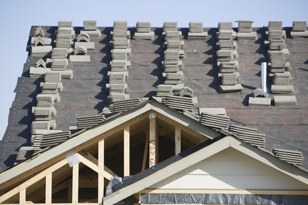 Stacks of tiles on house roof Stock Photo - 5470308
