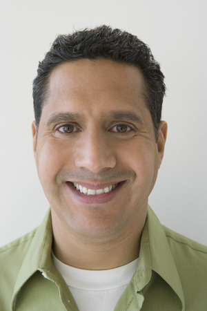 middle easterners: Studio portrait of man smiling