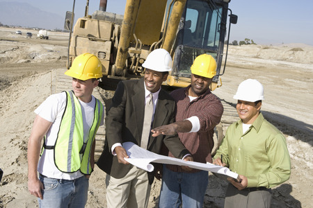 middle easterners: Surveyor and construction workers on site LANG_EVOIMAGES