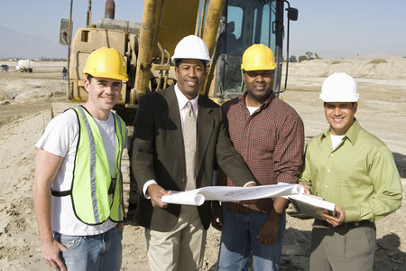 Surveyor and construction workers on site, portrait Stock Photo - 5470355