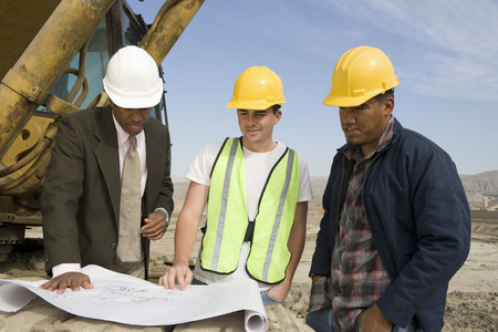 Surveyor and construction workers on site Stock Photo - 5470362