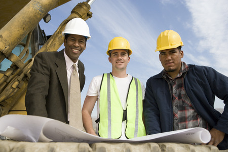 construction worker: Surveyor and construction workers on site, portrait LANG_EVOIMAGES