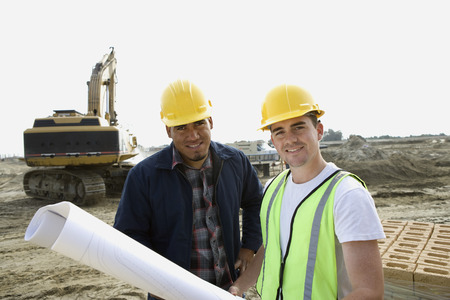 Construction workers with blueprints on site, portrait Stock Photo - 5470379