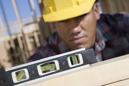 Construction worker using spirit level Stock Photo - 5470452