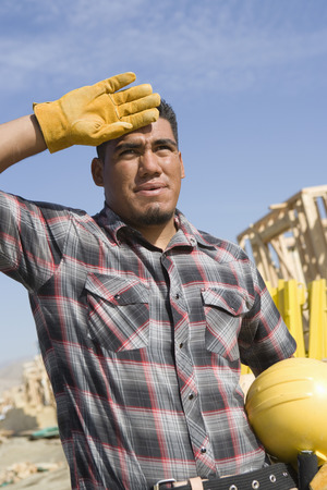 Construction worker wiping his forehead with his hand Stock Photo - 5470471