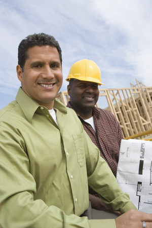 Architect and construction worker on construction site Stock Photo - 5470482