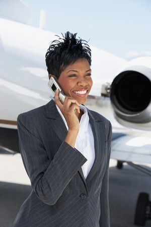 hooked up: Businesswoman Beside an Airplane