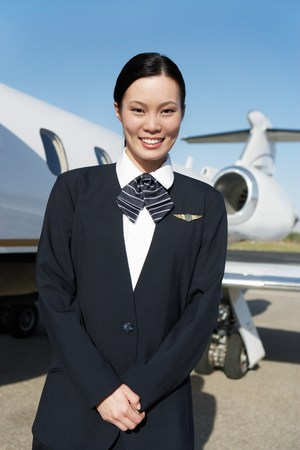 Stewardess Beside an Airplane Stock Photo - 5474969