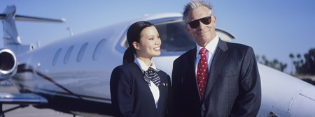 Businessman and Flight Crew Standing by Airplane Stock Photo - 5474976