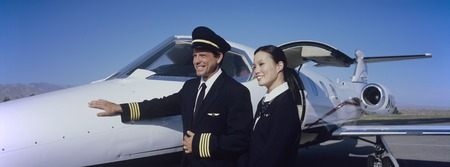 Members of Flight Crew Standing by Airplane Stock Photo - 5474978
