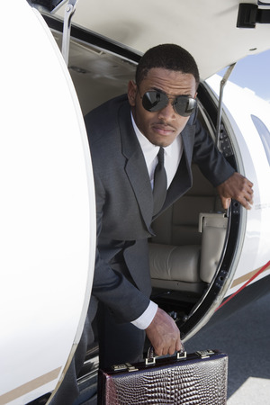 African-American businessman getting off airplane. Stock Photo - 5475014