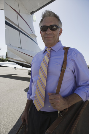 Senior businessman standing in front of private airplane. Stock Photo - 5475031