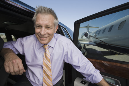 Portrait of senior businessman in front of car. Stock Photo - 5475032