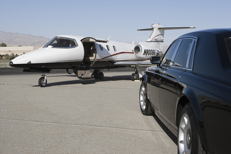 landing strip: Limousine and private jet on landing strip. LANG_EVOIMAGES