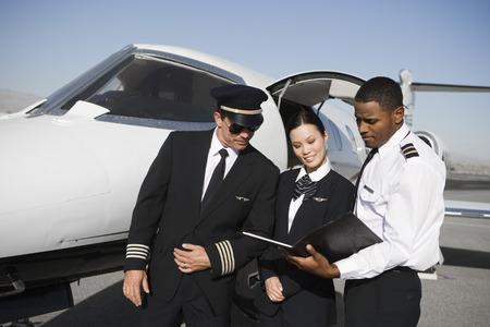 Aeroplane crew on runway. Stock Photo - 5475050