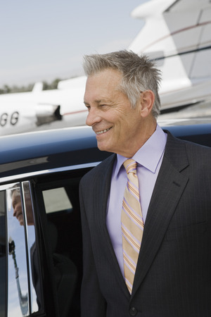Senior businessman in front of limousine and private jet. Stock Photo - 5475067