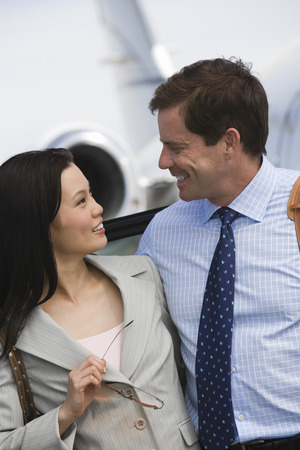 Mid-adult business couple smiling. Stock Photo - 5475083