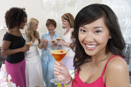 customs and celebrations: Friends Drinking Cocktails at Bridal Shower LANG_EVOIMAGES