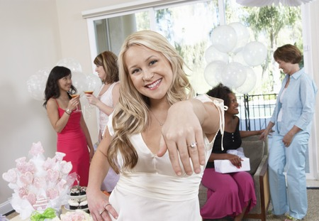 Bride Showing Off Ring at Bridal Shower Stock Photo - 5475106