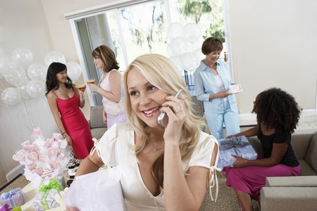Bride Talking on Cell Phone During Bridal Shower Stock Photo - 5475107