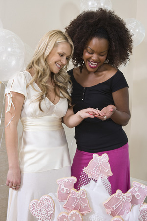 Bride showing friend her engagement ring at Bridal Shower Stock Photo - 5475138