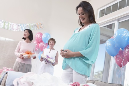 Pregnant Woman with Hands on Her Stomach Stock Photo - 5475204