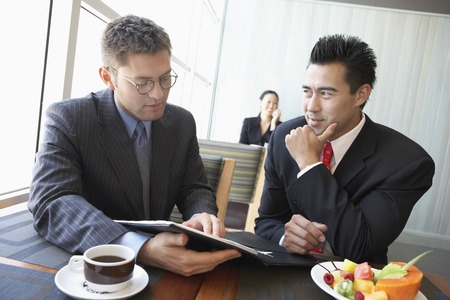 late thirties: Two Businessmen in Lunch Meeting