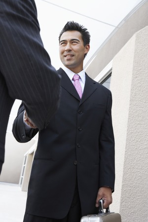early 30s: Two Businessmen Shaking Hands