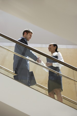 Businessman and Businesswoman on Escalator Stock Photo - 5475359
