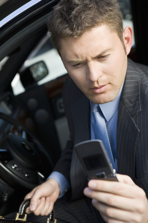 Business man using mobile phone in car Stock Photo - 5475418