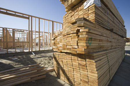 House construction and stack of planks Stock Photo - 5475458