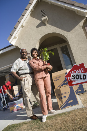 Middle-aged couple in front of their new house Stock Photo - 5475469